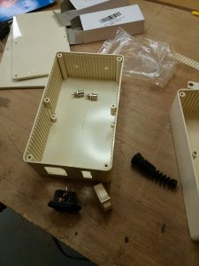 a plastic box adapted with holes for wiring