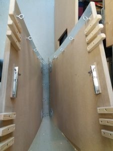Parts of the desk top with latches and fingers to hold them together