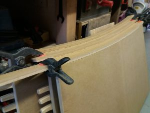 curved desk top parts clamped together
