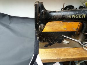 the canvas being sewn in an old singer machine